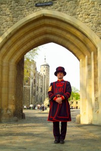Yeoman Warder outside the Tower of London wearing the iconic blue undress uniform with royal livery introduced in 1858.